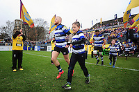Tom Homer of Bath Rugby, mascot in hand, runs out onto the field. Aviva Premiership match, between Bath Rugby and Saracens on December 3, 2016 at the Recreation Ground in Bath, England. Photo by: Patrick Khachfe / Onside Images