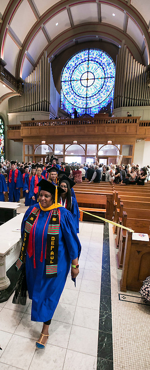 Graduates make their way into the Saint Vincent de Paul Parish Church on DePaul University's Lincoln Park Campus to participate in a Baccalaureate Mass Friday, June 10, 2016. The event was part of the 118th commencement ceremonies for the Chicago university. (DePaul University/Jamie Moncrief)