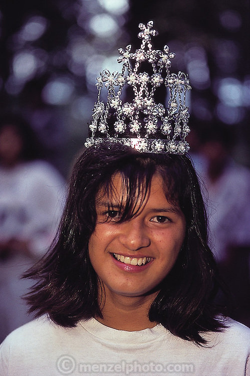 A blushing teenager crowned Jumil Queen at the annual Jumil festival, which celebrates the edible iodine-rich flying stinkbug, the jumil (Euchistus taxcoensis). Taxco, Mexico. (Man Eating Bugs page 14)