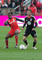 06 October 2012: D.C. United midfielder/forward Chris Pontius #13 and Toronto FC defender Aaron Maund #21 in action during an MLS game between DC United and Toronto FC at BMO Field in Toronto, Ontario Canada. .