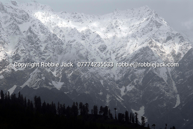 The original name for the Kullu valley was Kulantapith -the end of the habitable world.It is a narrow alpine valley drained by the Beas River and enclosed by the Pir Panjal to the north,the Bara Bangahal range to the west and the Parvati range to the east.This view is looking northwest from Vashisht  towards the Solang Valley and the Rohtang Pass.