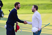 Dustin Johnson (USA) and Brandon Grace (RSA) shake hands after their match during round 3 Four-Ball of the 2017 President's Cup, Liberty National Golf Club, Jersey City, New Jersey, USA. 9/30/2017.<br /> Picture: Golffile | Ken Murray<br /> <br /> All photo usage must carry mandatory copyright credit (&copy; Golffile | Ken Murray)