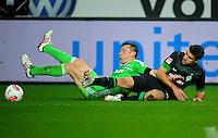 FUSSBALL   1. BUNDESLIGA    SAISON 2012/2013    13. Spieltag   VfL Wolfsburg - SV Werder Bremen                          24.11.2012 Ivica Olic (li, VfL Wolfsburg) gegen Sokratis Papastathopoulos (re, SV Werder Bremen)