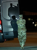 The shadow of a saluting Marine in on the door of the vehicle that will carry the transfer case containing the remains of United States Marine Corps Staff Sergeant Christopher A. Slutman to his family at Dover Air Force Base in Dover, Delaware on April 11, 2019.  The Door Attendant is Senior Airman Electa Hazenstab.  He died as the result of a road-side bomb in Afghanistan on April 8, 2019.  Staff Sergeant Slutman, a decorated 15 year veteran of the Fire Department of New York (FDNY), was married and had three children.<br /> Credit: Ron Sachs / CNP<br /> (RESTRICTION: NO New York or New Jersey Newspapers or newspapers within a 75 mile radius of New York City)