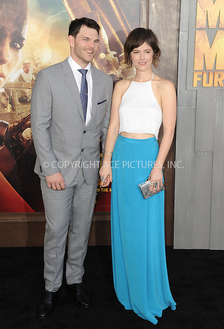 WWW.ACEPIXS.COM<br /> <br /> May 7 2015, LA<br /> <br /> Josh Helman and Jennifer Allcott arriving at the premiere  'Mad Max: Fury Road' at the TCL Chinese Theatre on May 7, 2015 in Hollywood, California. <br /> <br /> By Line: Peter West/ACE Pictures<br /> <br /> <br /> ACE Pictures, Inc.<br /> tel: 646 769 0430<br /> Email: info@acepixs.com<br /> www.acepixs.com