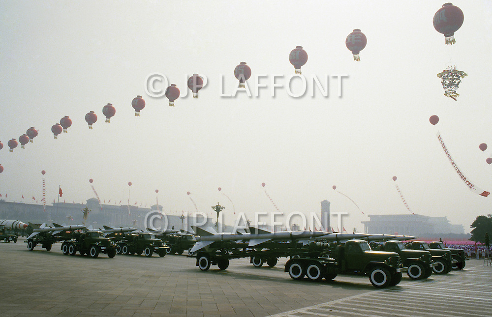 Beijing, China. October 1st, 1984. This huge parade is for the celebration of the 35th Anniversary of the Chinese Revolution. A military parade is a good opportunity for a country to show its nuclear power.