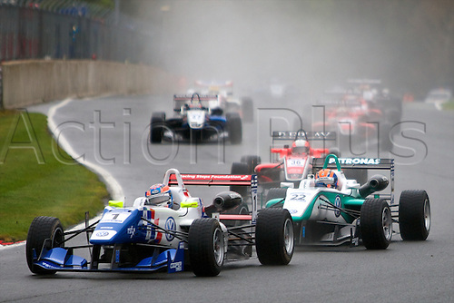 07.04.2012 Cheshire, England.  English driver Jack Harvey in his Carlin Dallara Volkswagenand Malaysian driver Jazeman Jaafar in his Carlin Dallara Volkswagen in action during rounds 1, 2 & 3 of the Cooper Tires British Formula 3 International Series at Oulton Park.