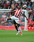 Saido Berahino of Stoke City is challenged by Nacho Monreal of Arsenal during the premier league match at the Britannia Stadium, Stoke. Picture date 19th August 2017. Picture credit should read: Robin Parker/Sportimage