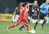 Branko Boskovic #27 of D.C. United closes in on Dwayne De Rosario #14 of Toronto FC during an MLS match that was the final appearance of D.C. United's Jaime Moreno at RFK Stadium, in Washington D.C. on October 23, 2010. Toronto won 3-2.
