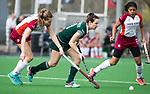 ALMERE - Hockey - Overgangsklasse competitie dames ALMERE- ROTTERDAM (0-0) .  Lisa van Baaren (R'dam)  met links Lucca van der Hoorn. COPYRIGHT KOEN SUYK