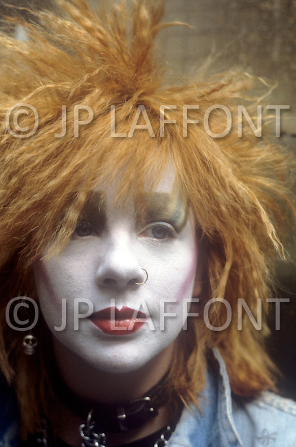 August 1981. Newcastle area, England. During this time the Punk movement begins, and tattoos, piercings, and colorful hair become popularized. At the same time the Romantic movement is born, and makeup, black and white clothing are the typical fashion seen at night clubs and dance parlors. Jane Haswell of Newcastle wears white makeup and spikey hair, both symbols of the Punk movement.