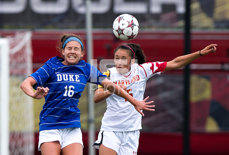 Erika Nelson (15) of Maryland goes up for a header with Laura Weinberg (16) of Duke at Ludwig Field on the campus of the University of Maryland in College Park, MD. DC. Duke defeated Maryland, 2-1.