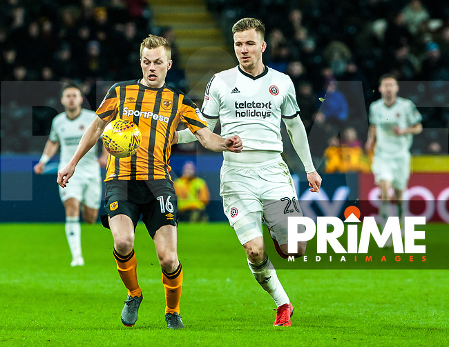 Hull City's midfielder Seb Larsson (16) holds off Sheffield United's midfielder Lee Evans (20) during the Sky Bet Championship match between Hull City and Sheff United at the KC Stadium, Kingston upon Hull, England on 23 February 2018. Photo by Stephen Buckley / PRiME Media Images.