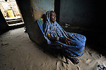 Mariam Mohammed is a woman who fled Timbuktu, a city in northern Mali, when it was seized by Islamist fighters in 2012. She returned home in May, 2013, after the city and region had been liberated by French and Malian soldiers. Here she sits in the doorway of her one-room home in Timbuktu.