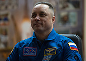 Expedition 54 Soyuz Commander Anton Shkaplerov of Roscosmos is seen in quarantine, behind glass, during a press conference, Saturday, December 16, 2017 at the Cosmonaut Hotel in Baikonur, Kazakhstan. Shkaplerov, flight engineer Scott Tingle of NASA, and flight engineer Norishige Kanai of Japan Aerospace Exploration Agency (JAXA) are scheduled to launch to the International Space Station aboard the Soyuz spacecraft from the Baikonur Cosmodrome on December 17.  <br /> Mandatory Credit: Joel Kowsky / NASA via CNP