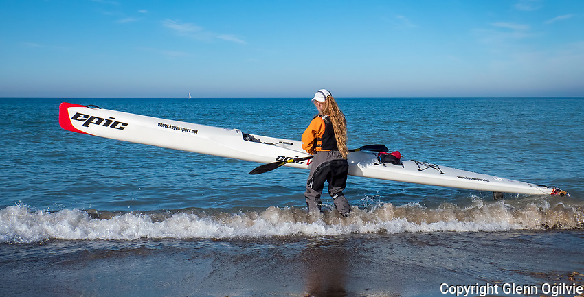 """Nicole Doyon, of Sarnia prepares her 19 foot 27 pound surf ski kayak for a chilly, but comfortable workout on Lake Huron, Sunday Dec. 16. """"There's no ice and it's a beautiful day,"""" said the artist, photographer and martial arts instructor. Nicole trains whenever possible for marathon racing held around Ontario. She has been kayaking for eight years and started racing two years ago."""