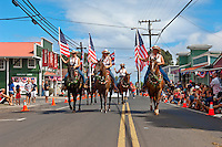 Horseback riders, Fourth of July parade in Makawao, Maui