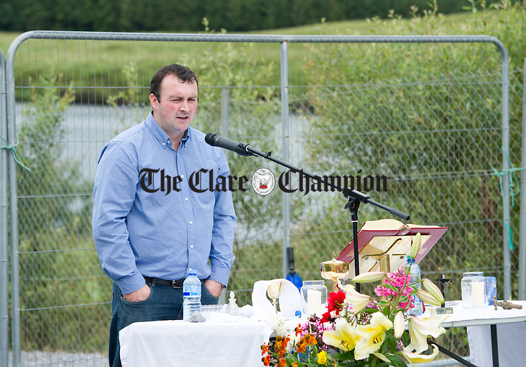 Chairperson of the water scheme Noel Carmody speaking during the Kilmaley Meitheal annual open air mass to celebrate and bless the local water scheme at Lough na Minna. Photograph by John Kelly.