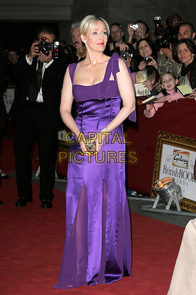 JK ROWLING.The Galaxy British Book Awards held at the Grosvenor Hotel, Park Lane, London, England. .April 9th 2008 .full length dress purple cleavage gold clutch bag J.K. Joanne.CAP/AH.©Adam Houghton/Capital Pictures.