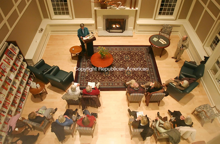 SOUTHBURY, CT 11/16/07- 111607BZ12- Polly Brody reads poetry from one of her books during a program in the fireplace room at the Southbury Public Library Friday night.<br /> Jamison C. Bazinet Republican-American