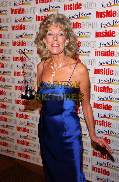 SUE NICHOLS.The Inside Soap Awards, La Rascasse, Cafe Grand Prix.Monday, September 27th, 2004.half length, award, trophy, blue dress, silk, satin.www.capitalpictures.com.sales@capitalpictures.com.© Capital Pictures.