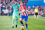 Filipe Luis of Atletico de Madrid competes for the ball Rafinha Alcantara of Futbol Club Barcelona  during the match of Spanish La Liga between Atletico de Madrid and Futbol Club Barcelona at Vicente Calderon Stadium in Madrid, Spain. February 26, 2017. (ALTERPHOTOS)