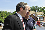 MAY 30, 2011 - LITTLE NECK, NY: New York Governor Andrew M. Cuomo marching with supporters in Little Neck-Douglaston Memorial Day Parade, on Northern Boulevard, Little Neck, New York, USA, on May 30, 2011. photo © Ann Parry, All rights reserved, Ann-Parry.com