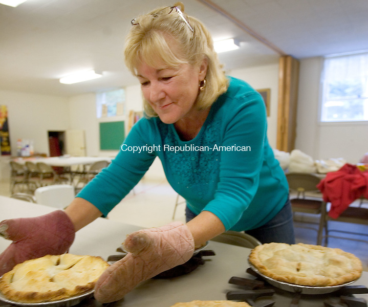 HARWINTON CT. 29 October 2015-100115SV05-Linda Colasurdo of Harwinton cools the apple pies at The Harwinton Congregational Church in Harwinton Thursday. The fundraising committee was baking 50 pies to sell at the Harwinton Fair this weekend. The group will be selling the pies along with other items as part of the church fundraiser. The Harwinton Fair is October 2nd to 4th.<br /> Steven Valenti Republican-American