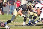 Palos Verdes, CA 11/12/10 - Blake Allman (Peninsula #77) in action during the Palos Verdes - Peninsula varsity football game at Peninsula High School.