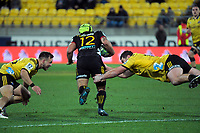 Wes Goosen and Ben May tackle Charlie Ngatai during the Super Rugby quarterfinal match between the Hurricanes and Chiefs at Westpac Stadium in Wellington, New Zealand on Friday, 20 July 2018. Photo: Dave Lintott / lintottphoto.co.nz