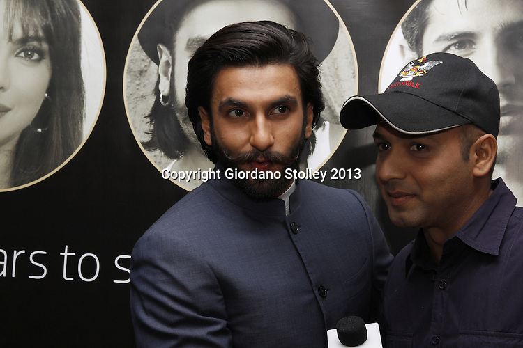 DURBAN - 5 September 2013 - Bollywood star Ranveer Singh (left) has a moment of fun with interviewer Faridoon Shahrya of Bollywood Hungama in Durban, South Africa, where Singh is attending the South Africa India Film and Television Awards. Picture: Giordano Stolley