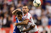 Jonny Steele (22) of the New York Red Bulls battles Kellyn Kai Perry-Acosta (23) of FC Dallas for the ball. The New York Red Bulls defeated FC Dallas 1-0 during a Major League Soccer (MLS) match at Red Bull Arena in Harrison, NJ, on September 22, 2013.