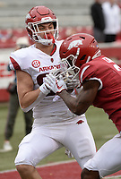 NWA Democrat-Gazette/ANDY SHUPE<br /> Arkansas tight end Grayson Gunter (left) makes a catch in the end zone Saturday, April 6, 2019, as he is hit by defensive back Kamren Curl during the Razorbacks' spring game in Razorback Stadium in Fayetteville. Visit nwadg.com/photos to see more photographs from the game.