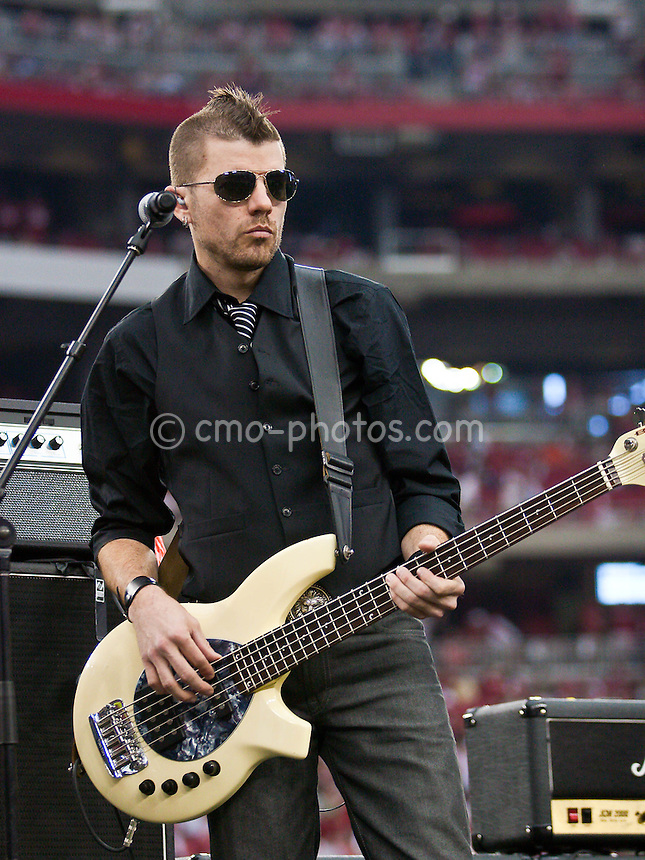 Jan 18, 2009; Glendale, AZ, USA; Will Turpin, bass guitarist for Collective Soul, plays during halftime of the NFC Championship Game between the Philadelphia Eagles and the Arizona Cardinals at University of Phoenix Stadium.  The Cardinals won the game 32-25 to advance to Super Bowl XLIII.