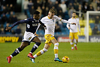 Jack Stobbs of Sheffield Wednesday takes on Fred Onyedinma of Millwall during the Sky Bet Championship match between Millwall and Sheff Wednesday at The Den, London, England on 20 February 2018. Photo by Carlton Myrie.