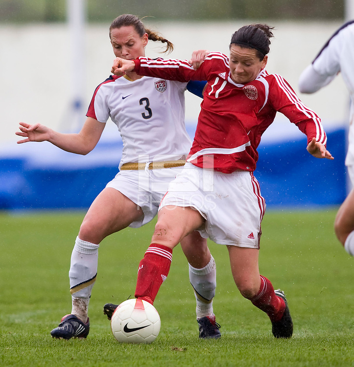 USWNT captain Christie Rampone (3) fights for the ball with Denmark's (11) Merete Pedersen during the opening match of the Algarve Cup.  The USWNT defeated Denmark, 2-0, in Lagos, Portugal.