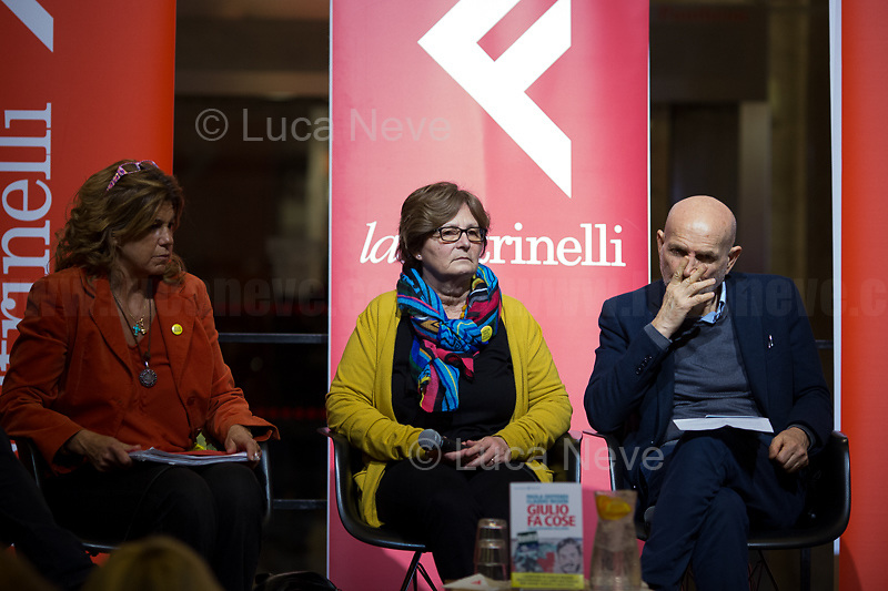 "Rome, 03/02/20. The Galleria Alberto Sordi (outside la Feltrinelli store) was the venue for the book presentation ""Giulio Fa Cose"" (Giulio Does Things, Ed. la Feltrinelli, 1.) written by Paola Deffendi and Claudio Regeni (Giulio Regeni's Parents), and Alessandra Ballerini (Regeni's Lawyer). The event was hosted by Marino Sinibaldi (Journalist, literary critic, Radio host). Reader was Valerio Mastandrea (Director & Actor). From la Feltrinelli's website: «The world of politics has not yet responded to the tragedy of Giulio Regeni, who died on 25 January 2016 in Cairo. Al Sisi's Egypt did not respond. Indeed, it continues to sabotage the investigation into the kidnapping, torture and murder of the son of Paola and Claudio Regeni: in four years the Egyptians have killed five innocent people, invented incredible stories, falsified documents to remove suspects from their apparatuses. But without succeeding[…]» (1.)<br />