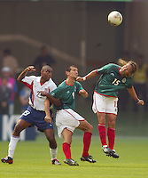 Luis Hernandez takes a header while USA's Eddie Pope and Mexico's Jared Borgetti lock arms. The USA defeated Mexico 2-0 in the Round of 16 of the FIFA World Cup 2002 in South Korea on June 17, 2002.