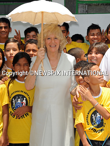 """CAMILLA, DUCHESS OF CORNWALL.Visits a centre for arts and education on a poor area of Manaus where the Duchess had a touching moment with one of the children of """"Curumim na Lata"""" (Children of the can-percussion)  ..Forth day Brazil on the second leg of their South American Tour, Manaus, Brazil_14/03/09....Mandatory Credit Photo: ©DIAS-NEWSPIX INTERNATIONAL..Please telephone : +441279324672 for usage fees..**ALL FEES PAYABLE TO: """"NEWSPIX INTERNATIONAL""""**..IMMEDIATE CONFIRMATION OF USAGE REQUIRED:.Newspix International, 31 Chinnery Hill, Bishop's Stortford, ENGLAND CM23 3PS.Tel:+441279 324672  ; Fax: +441279656877.Mobile:  07775681153.e-mail: info@newspixinternational.co.uk"""