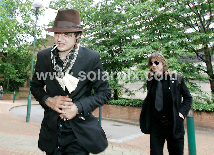 **ALL ROUND PICTURES FROM SOLARPIX.COM**.**NO UK NEWSPAPER PUBLICATION **UK MAGAZINE PUBLICATION ONLY** AND NO PUBLICATION IN FRANCE, SCANDINAVIA, AUSTRALIA AND GERMANY** .Pete Doherty sticks out his tongue as he leaves West London Magistrates Court  in London this afternoon after his case was adjourned..JOB REF:  4209       SFE       DATE: 3.07.07.**MUST CREDIT SOLARPIX.COM OR DOUBLE FEE WILL BE CHARGED* *UNDER NO CIRCUMSTANCES IS THIS IMAGE TO BE REPRODUCED FOR ANY ONLINE EDITION WITHOUT PRIOR PERMISSION*