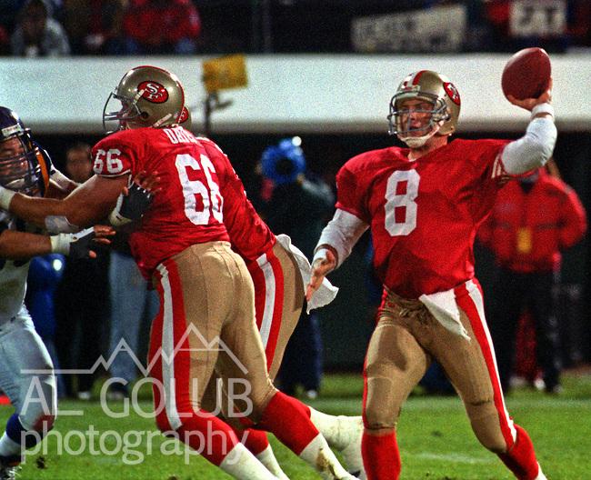 San Francisco 49ers vs. Minnesota Vikings at Candlestick Park Monday, December 18, 1995.  49ers beat Vikings  37-30.  San Francisco 49ers center Bart Oates (66) blocks for quarterback Steve Young (8).