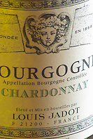 Closeup close-up of a wine bottle label Maison Louis Jadot Bourgogne Chardonnay Appellation Bourgogne Controlee with the Baccus Bacchus symbol of the producer founded in 1859, Maison Louis Jadot, Beaune Côte Cote d Or Bourgogne Burgundy Burgundian France French Europe European