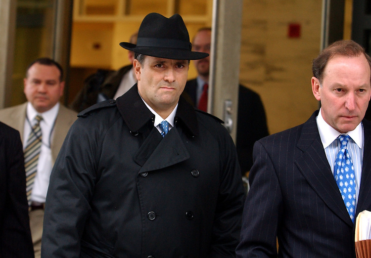 Jack Abramoff, center, leaves the Prettyman Federal Courthouse in Washington, D.C., after entering a plea agreement on three felony charges.  His attorney, Abbe Lowell, appears at right.