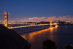 """The Night Life""  Golden Gate Bridge San Francisco, California. I have printed it as large as 48x84""s with it being hung in Board Rooms.  It is unusual for a night shot in a large print format to have such sharp detail of the Golden Gate Bridge and the City.  A few of the things I like in this photograph and in my opinion make it a ""One of a Kind"" are: the colors of the bridge, the shadows of the cables on the Pacific Ocean, looking at the ocean you can see how the waves are moving in several different directions (something not readily visible during the day), white clouds being illuminated by the city lights and are slightly blurry showing that they were moving, the detail of all the buildings and their light in the windows, the Trans America building on the left, the Presidio on the right, the little slivers of light in the sky are airplanes in flight, stars in the sky high above the city and the cars driving over the bridge look like a laser beam of light but when you look closely you can see little bubbles of light sticking out above the main stream of light due to the cars bouncing on the suspension bridge.  I didn't realize how much the vehicles bounced until I viewed their light trails while going over the bridge. I have four different images of this scene with some of them having the vehicle light trails only being little individual lines of light that look like little snakes.  I get asked a lot about the camera settings I used to capture this image so here they are: Picture taken on June 24th, 2012 at 9:32pm, ISO 400, 30 second exposure, f13.0 aperture, with a Canon 5D Mark ll and Canon F/2.8 L series lens set at 35mm."