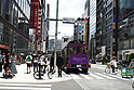 Miranda Kerr rides campaign vehicle through Tokyo shopping district