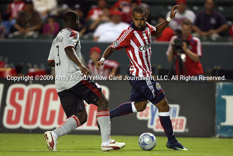 22 August 2009: Chivas USA's Maicon Santos (BRA) (right) is defended by Toronto's Nana Attakora (3). CD Chivas USA played Toronto FC at the Home Depot Center in Carson, California in a regular season Major League Soccer game.