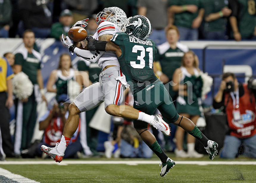 Ohio State Buckeyes wide receiver Devin Smith (9) can't come up with a catch against Michigan State Spartans cornerback Darqueze Dennard (31) in the 3rd quarter during the Big 10 Championship game at Lucas Oil Stadium in Indianapolis, Ind on December 7, 2013.  (Dispatch photo by Kyle Robertson)