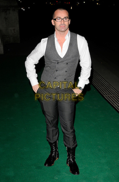 LOUIE SPENCE .The Spectacle Wearer Of The Year ceremony at Victoria & Albert Museum, London, England, UK, .November 10th 2010. .V&A full length waistcoat white shirt glasses hands in pockets trousers boots black grey gray .CAP/CAN.©Can Nguyen/Capital Pictures.