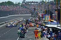 Verizon IndyCar Series<br /> Indianapolis 500 Race<br /> Indianapolis Motor Speedway, Indianapolis, IN USA<br /> Sunday 28 May 2017<br /> Leader Fernando Alonso, McLaren-Honda-Andretti Honda brings the field down pit lane for a caution flag pit stop.<br /> World Copyright: F. Peirce Williams<br /> LAT Images