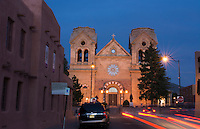Santa Fe New Mexico St Francis Cathedral famous church at night color with traffic moving
